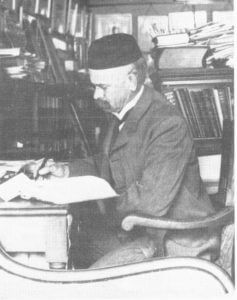 John Henry Comstock writing at his desk in the McGraw Tower room