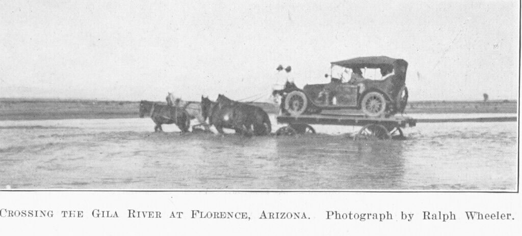 An early 1900's car on a trailer, being pulled by a team of horses cross the Gila River in Florence, Arizona