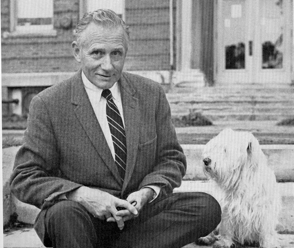 Professor John Franclemont and his dog Cho Cho in front of the original Comstock Hall